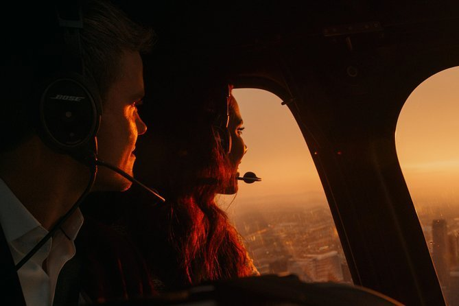 Couple looking over the city inside helicopter