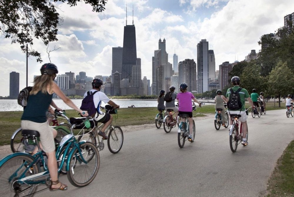 Group of people riding by Chicago's Lakefront Neighborhoods