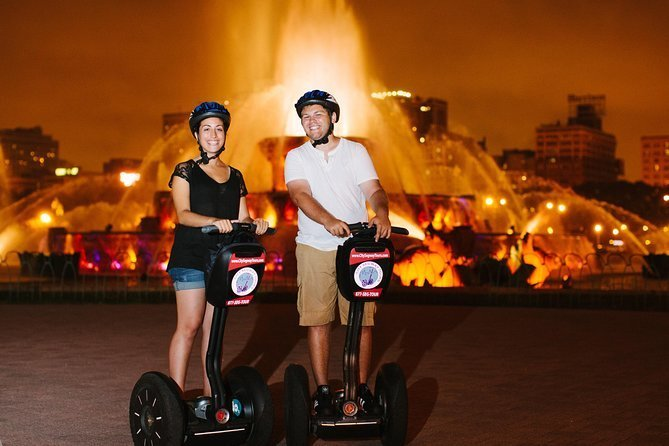Couple at night riding a Segway