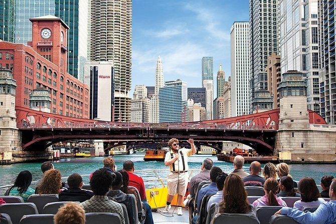 People listening to boat tour guide while looking at Lake Michigan
