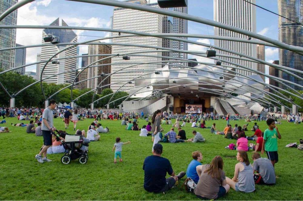 People enjoying live concert at city park _ Best time to visit Chicago
