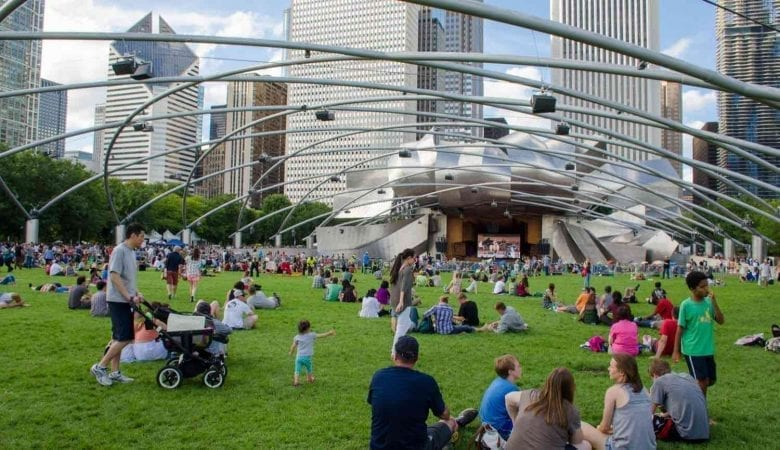 People enjoying live concert at city park _ Best time to visit Chicago