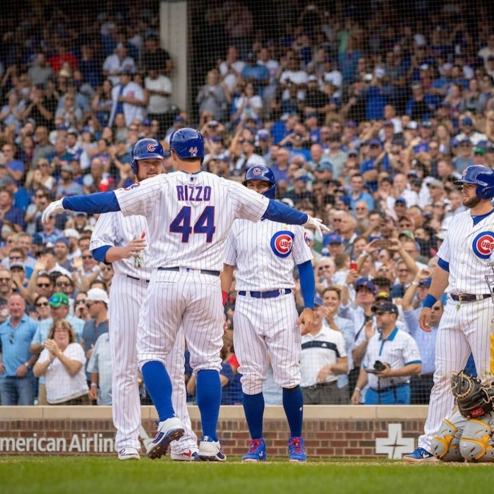 Cubs players celebrating at Wrigley Field