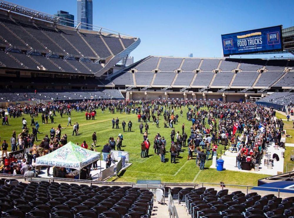 people at a stadium enjoying breweries