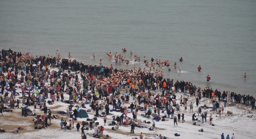 People jumping in the freezing waters