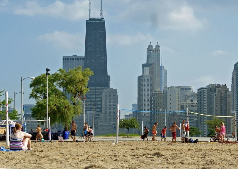 People playing volleyball on a sunny day at North Avenue Beach