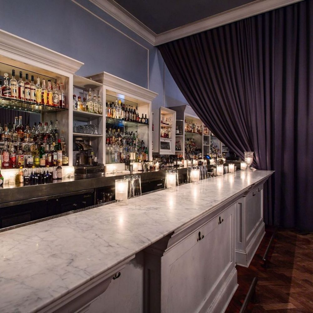 Bar with liquors in shelf and candles