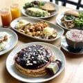 different brunch plates, pancakes, eggs, potatoes, sandwiches