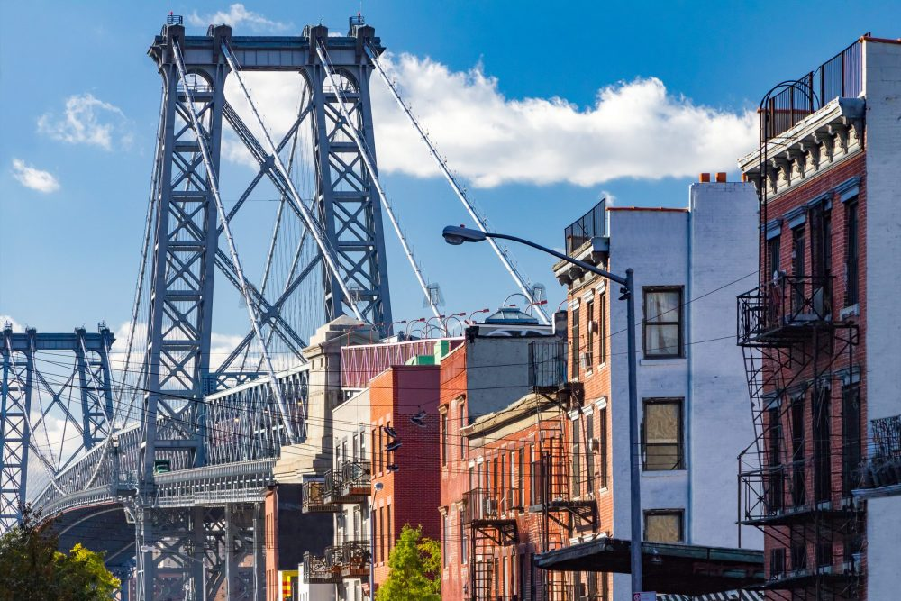 Brooklyn street scene with block of buildings near the Williamsburg Bridge   things to do in nyc
