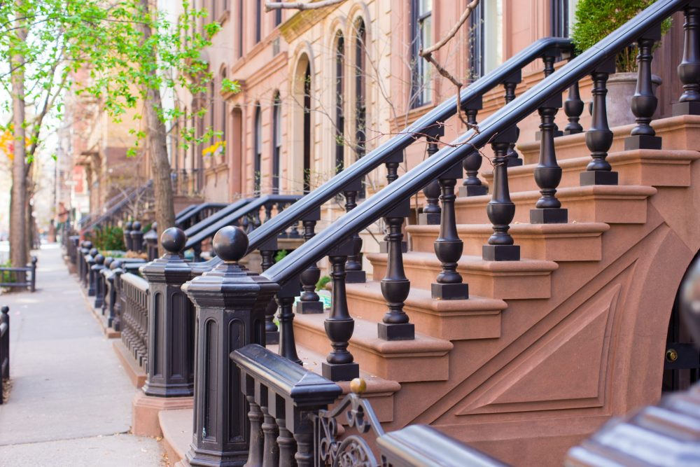 Old houses with stairs in the historic district of West Village | things to do in nyc