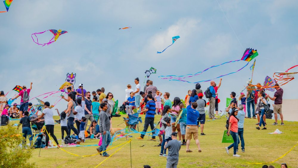 People flying kites at Hermann park and Miller Theatre | things to do in houston