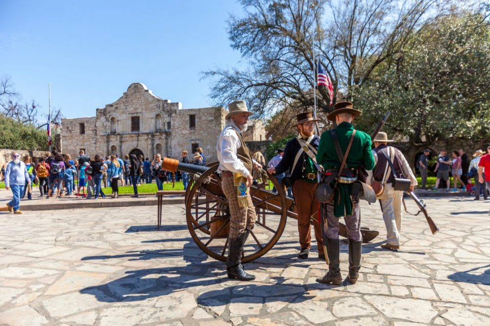 People get in line to visit the historical Alamo Mission, built in 1718 and site of the famous 1836 Battle of the Alamo