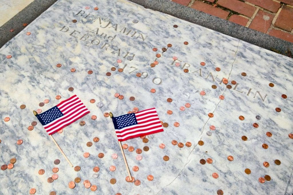Two flags for Ben Franklin's gravestone in Christ Church Burial Ground - Best things to do in Philadelphia