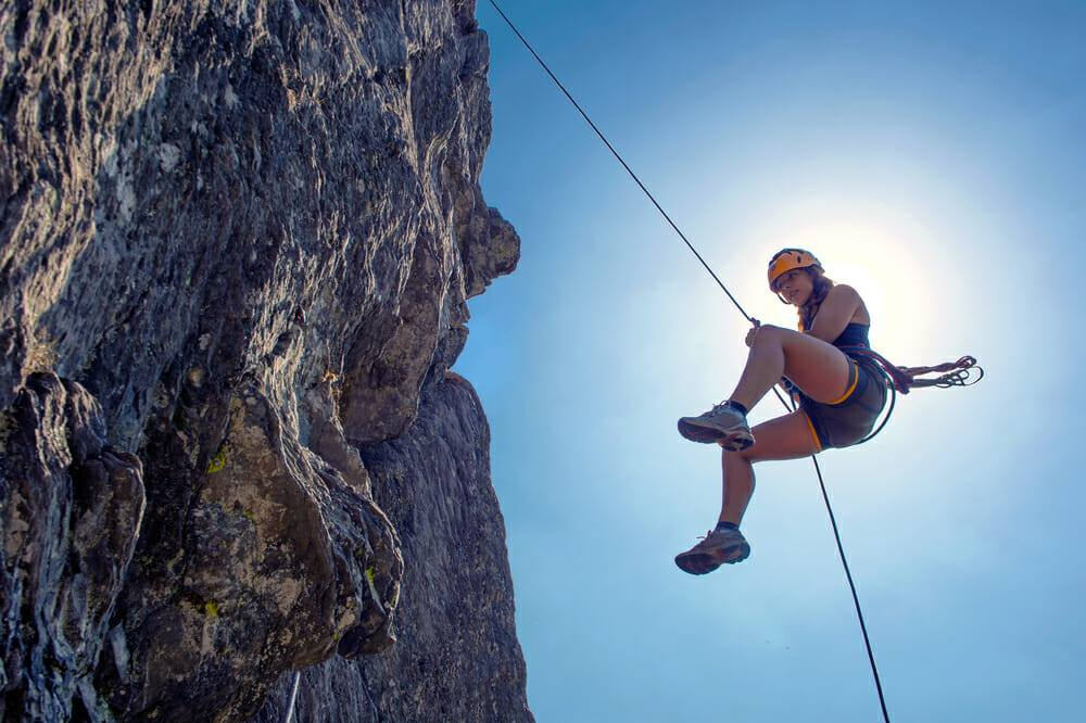 A Woman climbing at Denver Climbing Company | things to do in denver