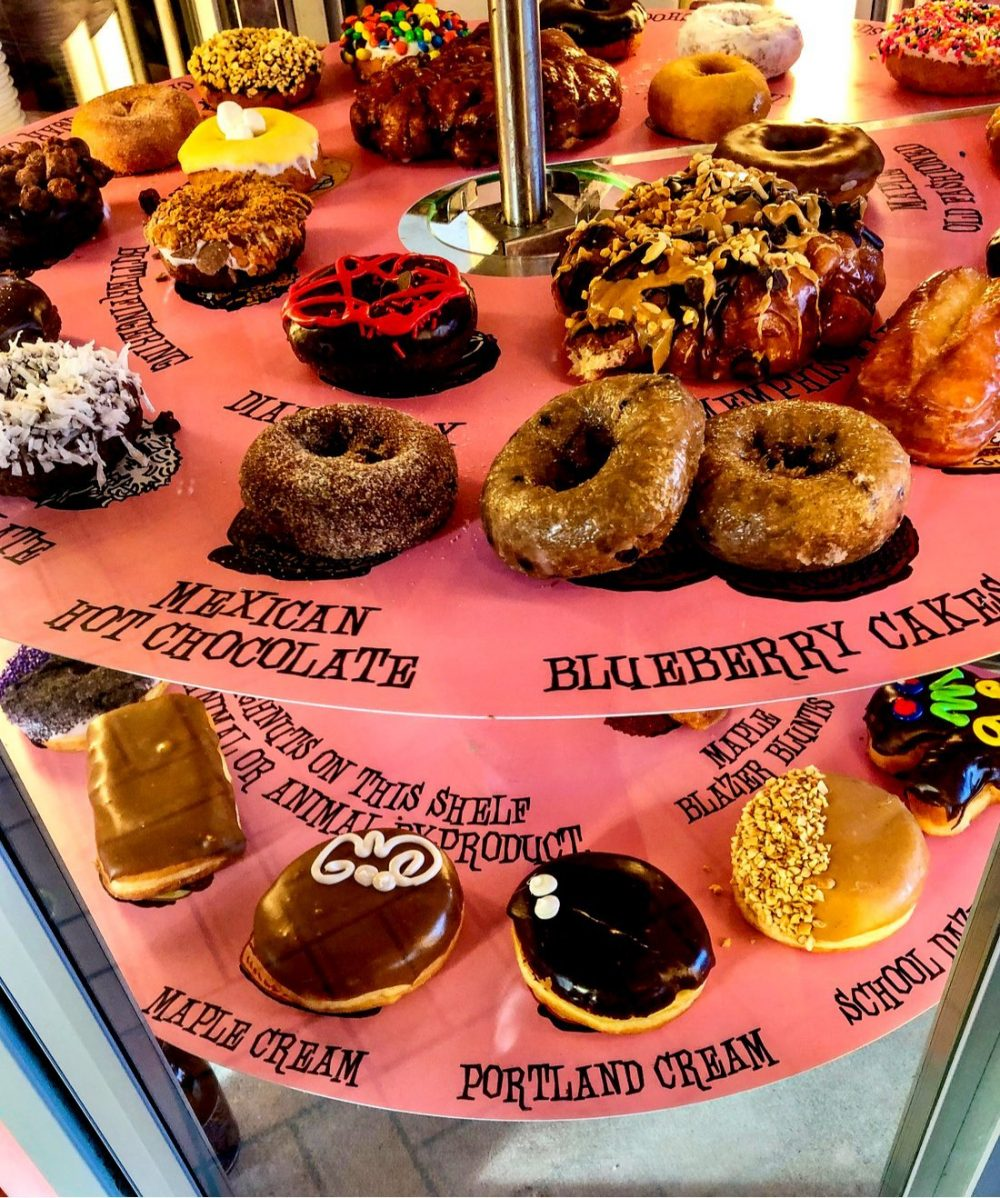 A view of various doughnuts displayed for sale at Voodoo Donuts | things to do in portland