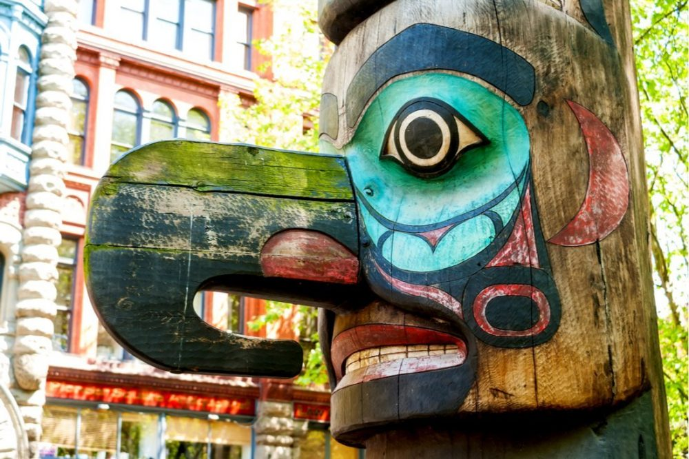 Face of Tlingit totem pole on Pioneer Square | things to do in seattle