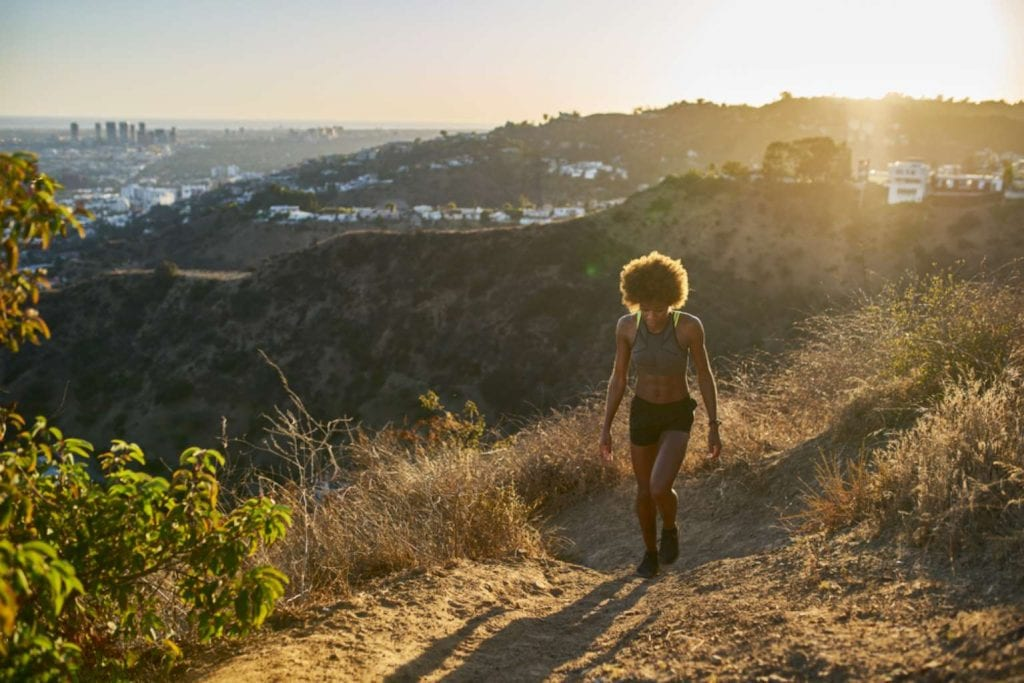 Fit woman hiking up Runyon Canyon at sunset Best things to do in LA