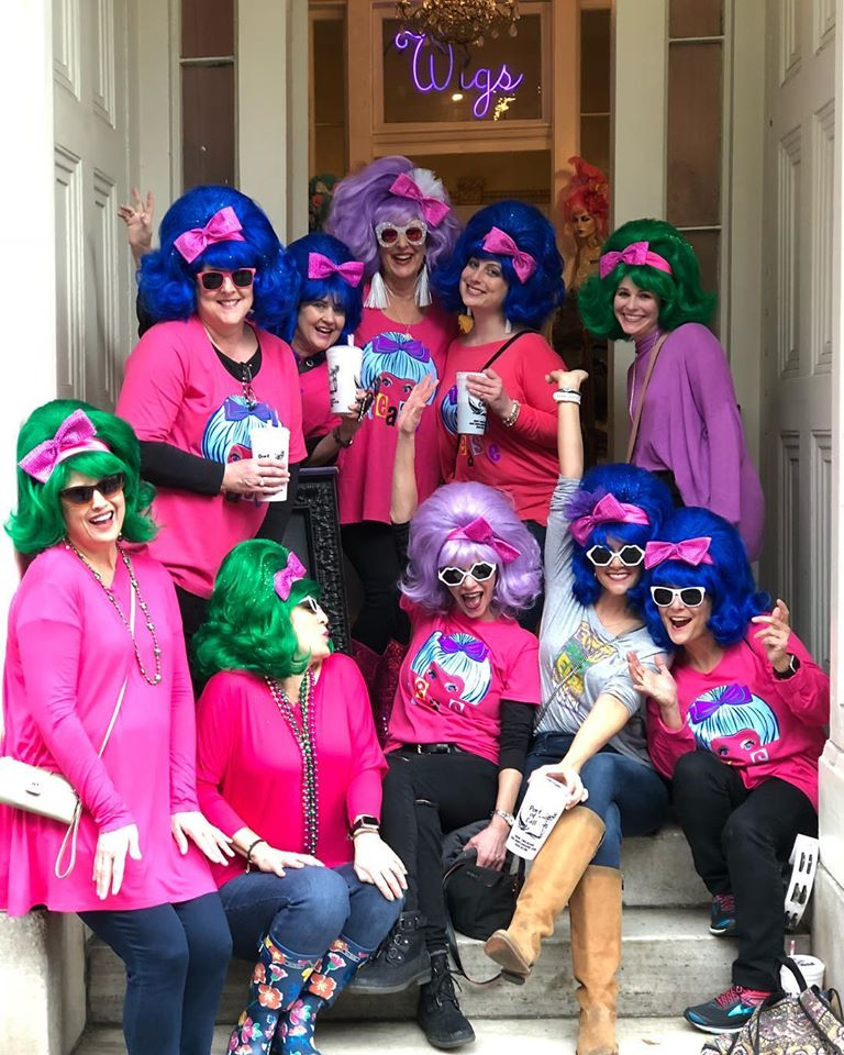 Girls on colorful wigs by Fifi Mahony's | things to do in new orleans