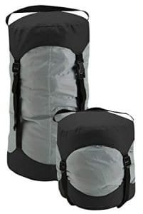 Black and gray compression travel bag, part of travel packing list