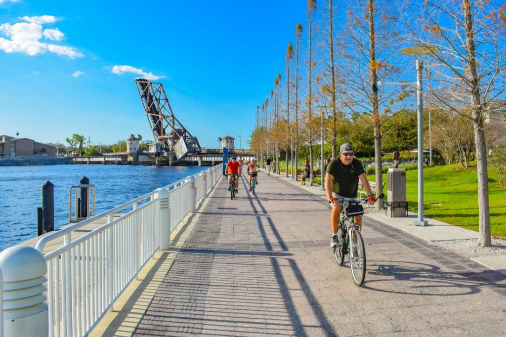 People biking at Riverwalk in downtown area | best things to do in tampa