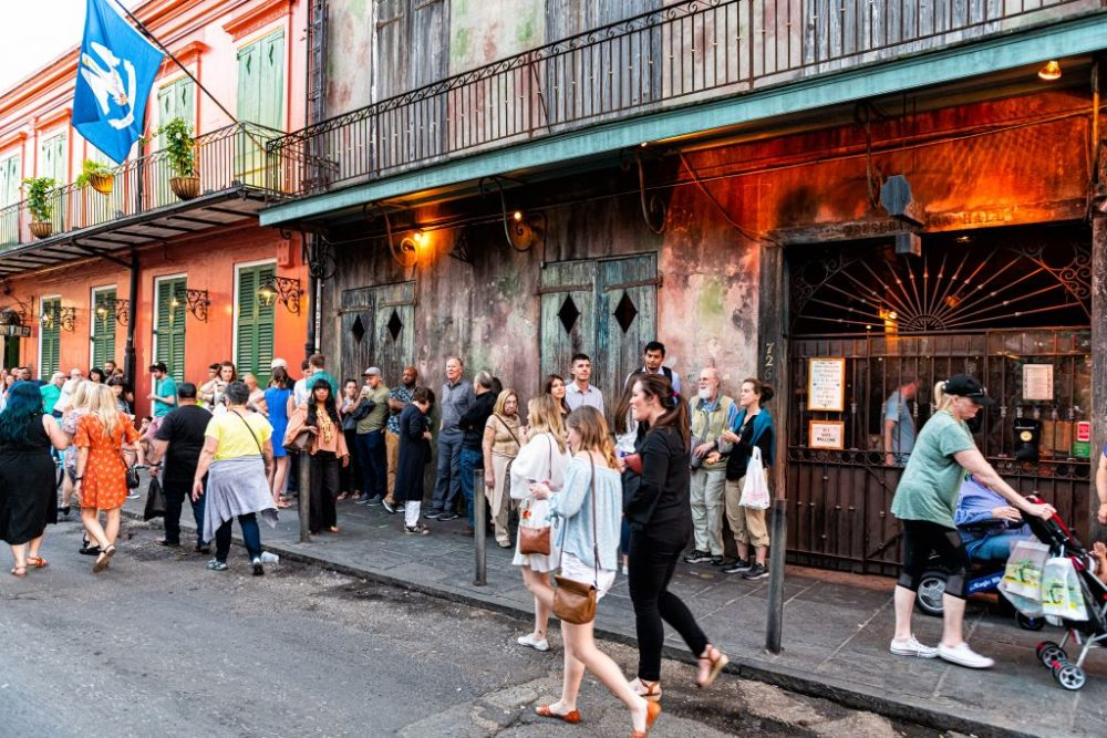 People standing in long sidewalk line waiting for Preservation Hall | best things to do in new orleans
