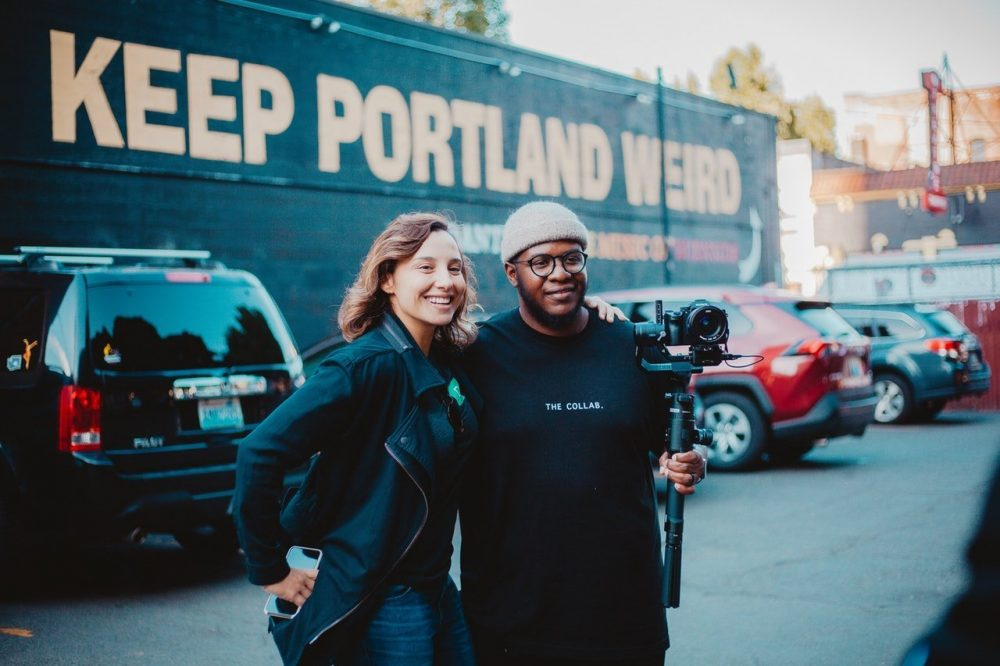 People taking pictures of Keep Portland Weird sign | things to do in portland