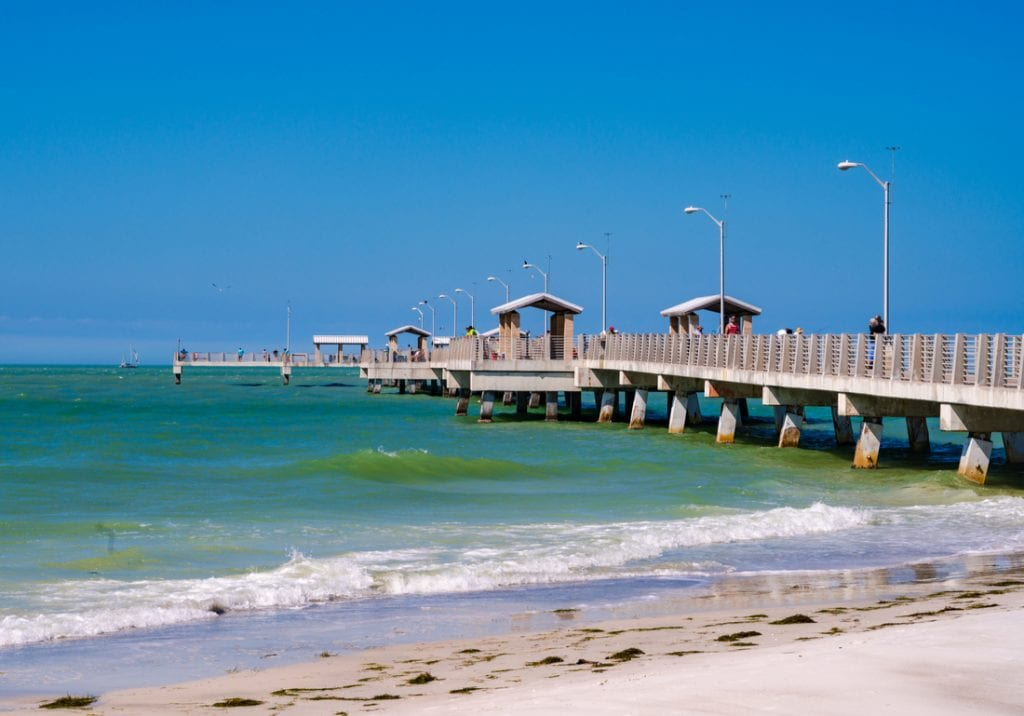 Photo of a long pier in the Gulf of Mexico with fishermen and tourists | best things to do in tampa