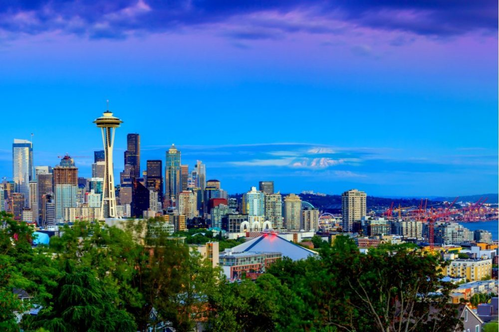 Seattle skyline panorama at sunset as seen from Kerry Park | Seattle skyline panorama at sunset as seen from Kerry Park - Photo by f11photo via Shutterstock
