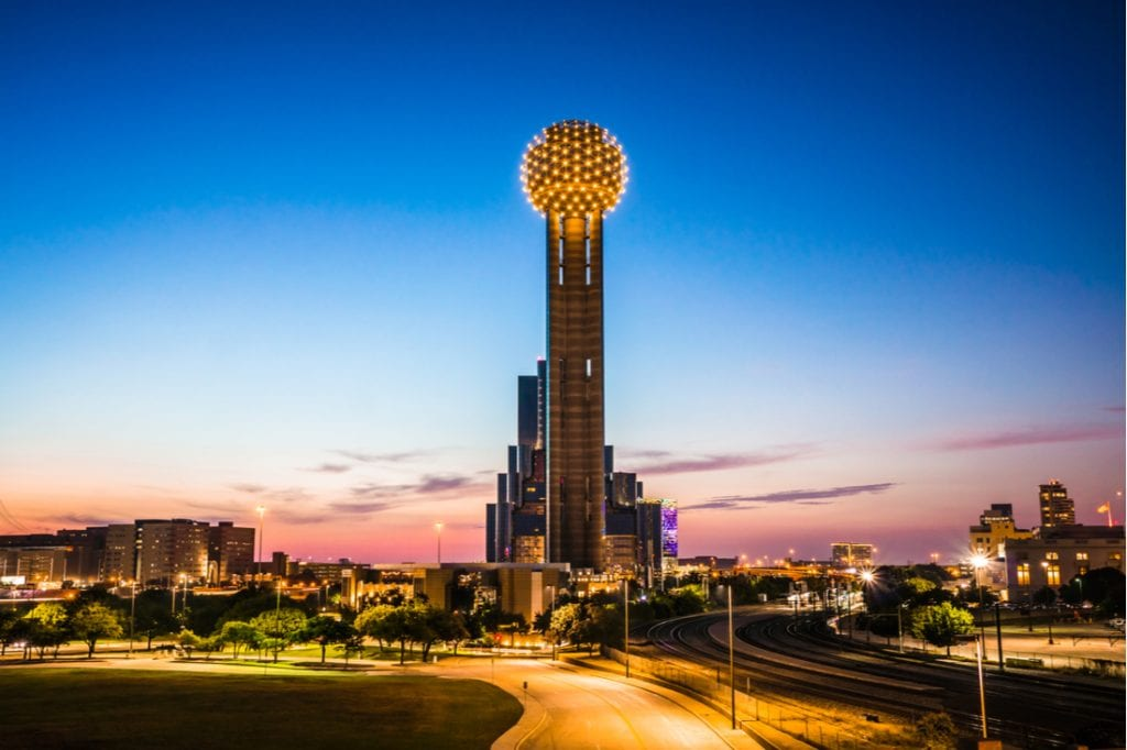 The Reunion Tower stands as the sun sets | best things to do in dallas