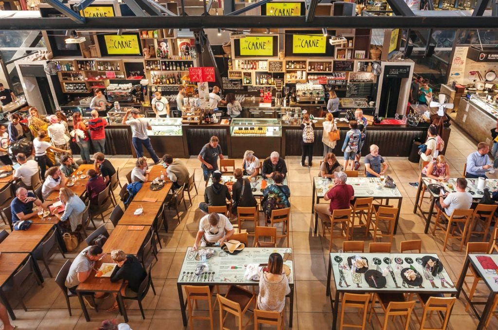 People having breakfast at popular food court inside Mercato Centrale city market   best things to do in florence