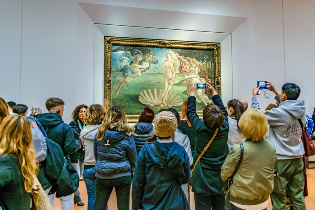 People taking photos of famous botticelli venus at ufizzi gallery at florence city, Italy   best things to do in florence