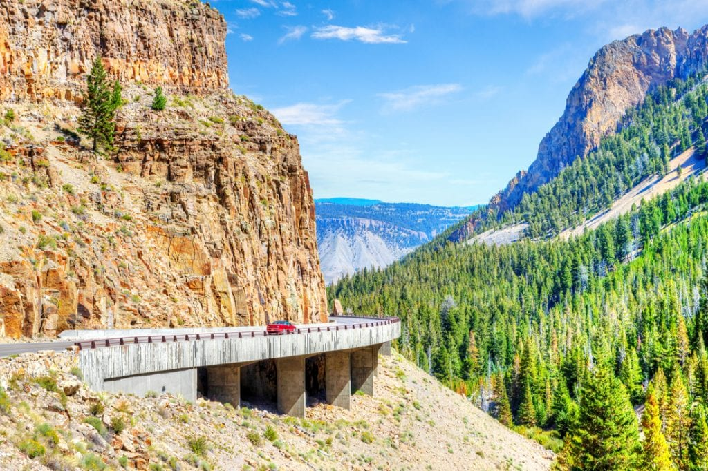 Red car on Grand Loop Road through Golden Gate Canyon | best things to do in yellowstone