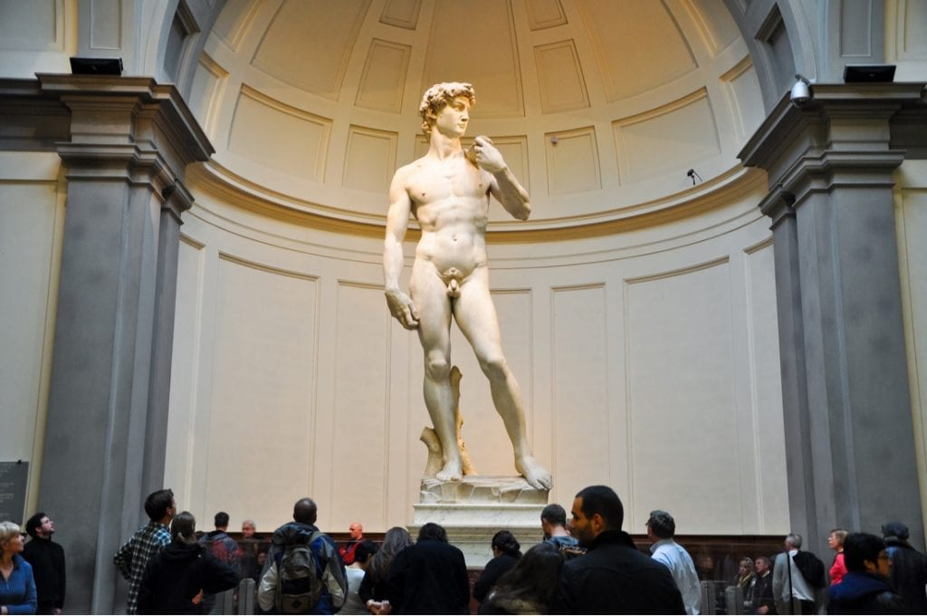Tourists look at David by Michelangelo in Galleria dell'Accademia in Florence   best things to do in florence
