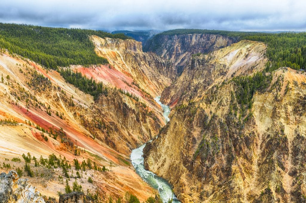 View at a vivid Grand Canyon of the Yellowstone and Yellowstone river seen from Artist Point | best things to do in yellowstone