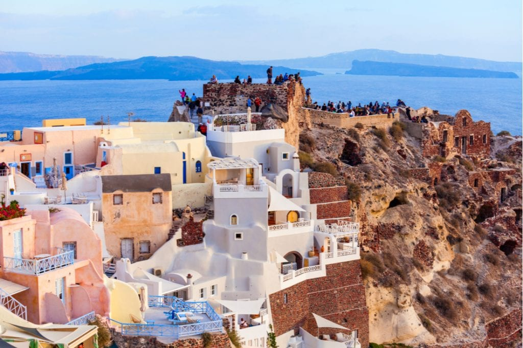 Byzantine Castle Ruins in Oia Santorini island in the Cyclades, Greece on sunset | best things to do in santorini