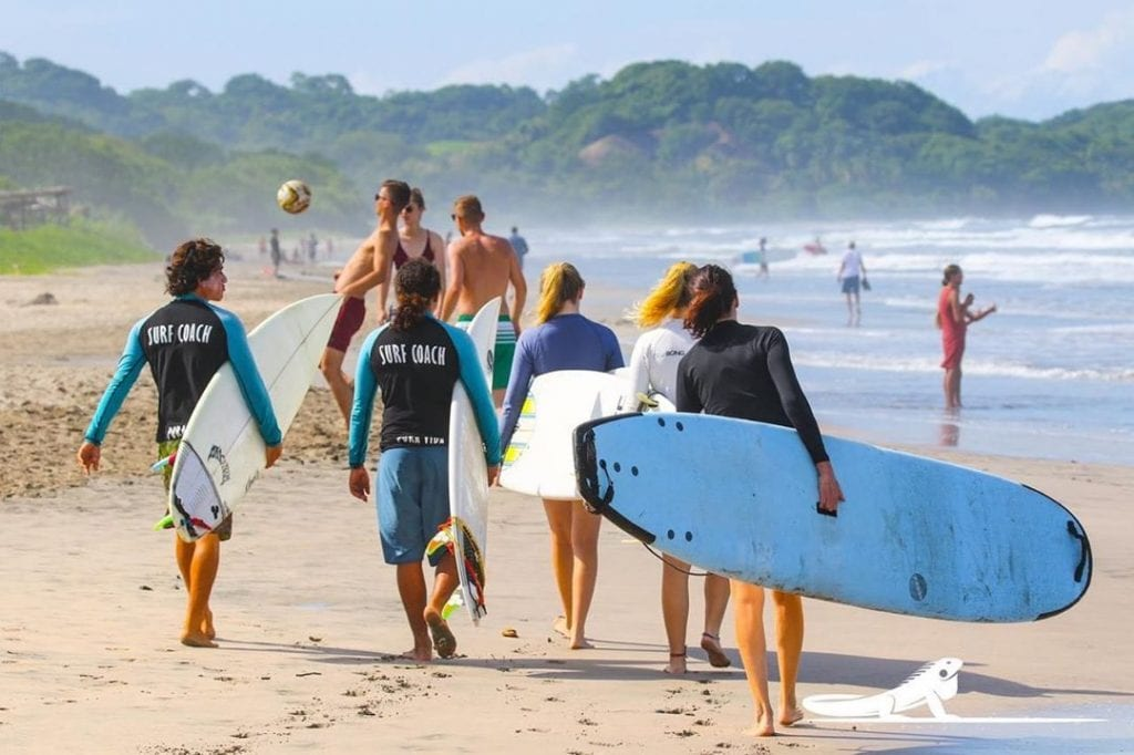 Group of surfers at Nosara Beach | things to do in costa rica