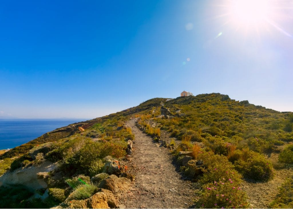 Hiking trail up the hill to the church, the trail over the sea from Oia to Fira in Santorini, Greece | best things to do in santorini