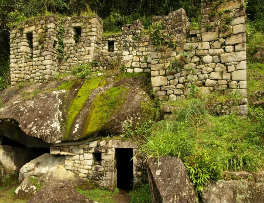 The ruins of the Temple of the Moon at the bottom of Wayna Picchu | best things to do in machu picchu