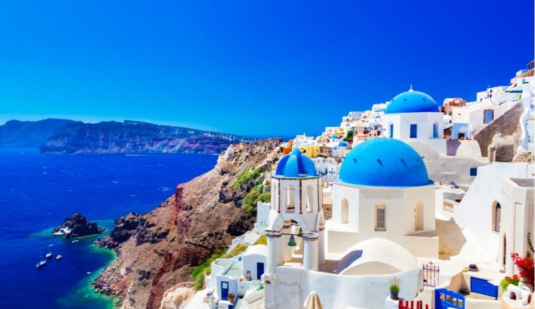 Traditional and famous houses and churches with blue domes over the Caldera, Aegean sea   best things to do in santorini